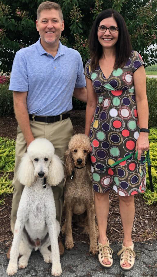 Dr. Morphis with her husband and their dogs